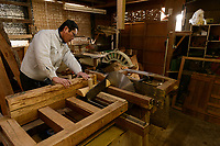 Masahara Nakajima, owner of Nakajima Seikichi Shoten, cutting wood to make shogi playing pieces. Tendo, Yamagata Prefecture, Japan, February 19, 2018. The city of Tendo in Yamagata Prefecture is famous for its shogi (Japanese chess) playing pieces. Production started early in the 19th century and Tendo still produces over 95% of the Shogi pieces made in Japan.