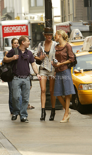 WWW.ACEPIXS.COM . . . . .  ....NEW YORK, SEPTEMBER 15, 2005....Carolyn Murphy exits a cab and gives a hug to another model outside her SoHo hotel.....Please byline: JENNIFER L GONZELES-ACE PICTURES.... *** ***..Ace Pictures, Inc:  ..Craig Ashby (212) 243-8787..e-mail: picturedesk@acepixs.com..web: http://www.acepixs.com