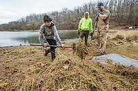 Jesus Sandoval (from left), 11, rakes up grass Wednesday, March 18, 2020, while doing landscaping work with father Alfredo Sandoval and Derrick Madison at Lake Atalanta Park in Rogers. Check out nwaonline.com/200319Daily/ for today's photo gallery.<br /> (NWA Democrat-Gazette/Ben Goff)
