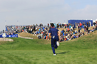 Rory McIlroy (Team Europe) races to the 3rd tee during the Friday Foursomes at the Ryder Cup, Le Golf National, Ile-de-France, France. 28/09/2018.<br /> Picture Thos Caffrey / Golffile.ie<br /> <br /> All photo usage must carry mandatory copyright credit (&copy; Golffile | Thos Caffrey)