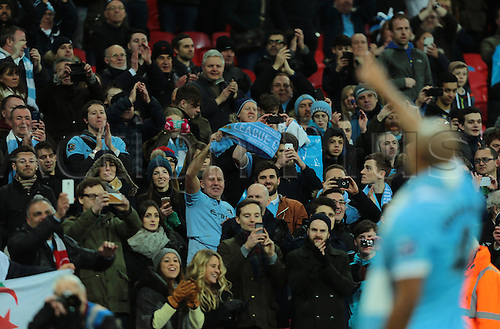 28.02.2016. Wembley Stadium, London, England. Capital One Cup Final. Manchester City versus Liverpool. Manchester City Captain Vincent Kompany wavesto his fans after winning the Capital One Cup Final