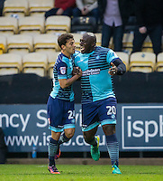 Adebayo Akinfenwa of Wycombe Wanderers celebrates scoring the opening goal with Scott Kashket of Wycombe Wanderers during the Sky Bet League 2 match between Notts County and Wycombe Wanderers at Meadow Lane, Nottingham, England on 10 December 2016. Photo by Andy Rowland / PRiME Media Images.