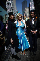 A woman dressed up as Statue of Liberty for a picture as they take part during the annual easter parade in Manhattan, New York, 03.27.2016. This annual tradition has been taking place in New York City for over 100 years, Photo by VIEWpress.