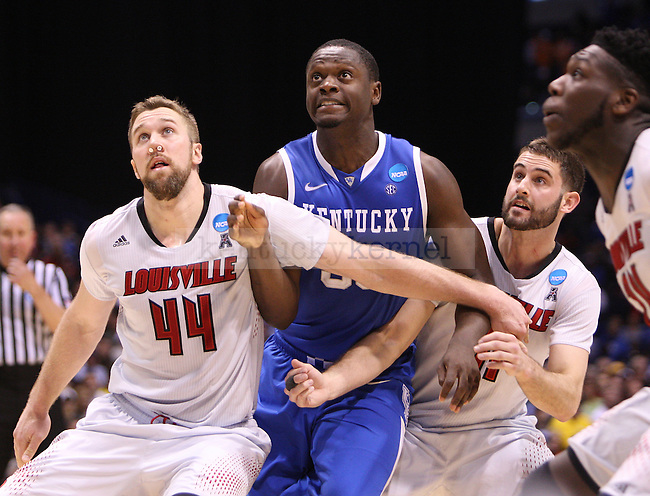 U of L forwards Stephan Van Treese  Luke Hancock and UK forward Julius Randle react after a free throw during the NCAA Sweet 16 vs. UofL at the Lucas Oil Stadium in Indianapolis , Ind., on Friday, March 28, 2014. Photo by Emily Wuetcher | Staff