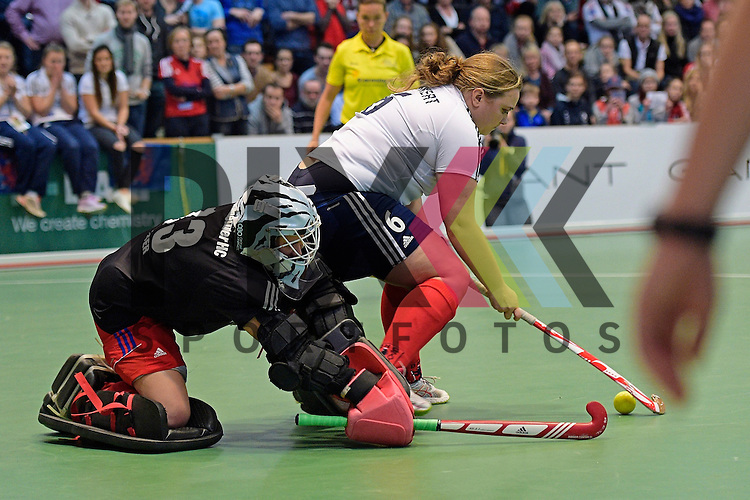 GER - Luebeck, Germany, February 07: During the 1. Bundesliga Damen indoor hockey final match at the Final 4 between Mannheimer HC (blue) and Duesseldorfer HC (white) on February 7, 2016 at Hansehalle Luebeck in Luebeck, Germany. Final score 6-4 after shootout.  Nadine Stelter #13 of Mannheimer HC, Sabine Markert #6 of Duesseldorfer HC