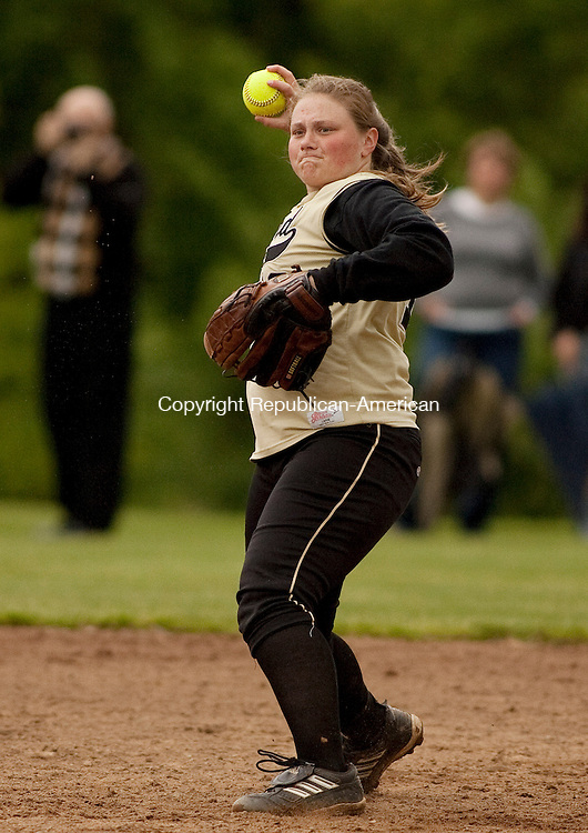 BEACON FALLS, CT- MAY 19 2010-051910JS04-Woodland's Aubrey Roulanaitis (16) throws to first for an out during their 3-1 win over Holy Cross Wednesday at Woodland Regional High School in Beacon Falls.<br /> Jim Shannon Republican-American