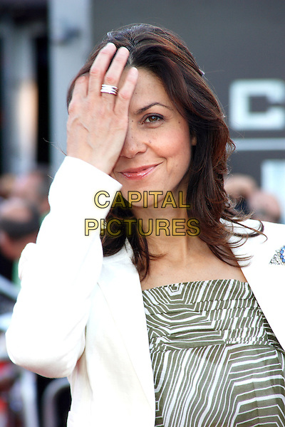 JULIA BRADBURY.UK Premiere of 'Cowboys and Aliens' at the Cineworld cinema at the O2 Arena, London, England..August 11th 2011.headshot portrait white jacket beige green print pattern top stripe half length hand covering face ring silver .CAP/ROS.©Steve Ross/Capital Pictures