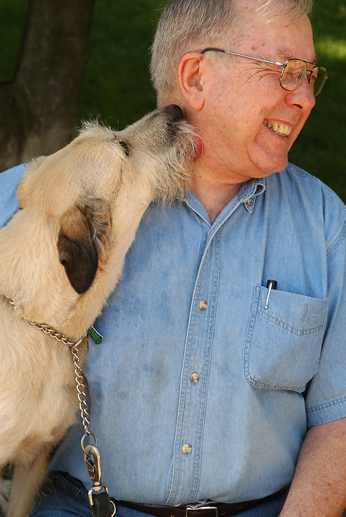dog1/063003 - Karl Fredric Schwengel of Capitol Hill, gets a lick from Lydia, in Lincoln Park.