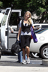 September 16th 2010  Exclusive .Filming the tv show Chuck in Los Angeles. .Yvonne Strahovski carrying a black gym bag & vest with a flower in her blonde hair...AbilityFilms@yahoo.com.805-427-3519.www.AbilityFilms.com