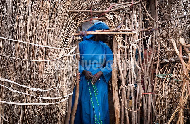 A woman in Kakuma refugee camp in Kenya.Kakuma refugee camp in North of Kenya. Kakuma is the site of a UNHCR refugee camp, established in 1991. The population of Kakuma town was 60,000 in 2014, having grown from around 8,000 in 1990. In 1991, the camp was established to host the 12,000 unaccompanied minors who had fled the war in Sudan and came walking from camps in Ethiopia.