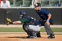 Catcher Max Sapp (27) of the Lexington Legends and home plate umpire Spencer Flynn at Fieldcrest Cannon Stadium in Kannapolis, NC, Sunday June 15, 2008.