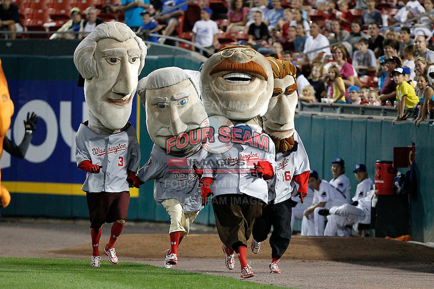 Washington Nationals mascots Thomas Jefferson, George Washington, Theodore Roosevelt, and Abe Lincoln participate in a race during a Buffalo Bisons game against the Syracuse Chiefs at Coca-Cola Field on September 1, 2011 in Buffalo, New York.  Syracuse defeated Buffalo 6-2.  (Mike Janes/Four Seam Images)