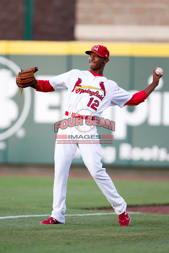Samuel Freeman (12) of the Springfield Cardinals tosses a ball to an outfield between innings during a game against the Tulsa Drillers at Hammons Field on July 19, 2011 in Springfield, Missouri. Tulsa defeated Springfield 17-11. (David Welker / Four Seam Images)