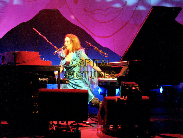 TORI AMOS.At Hammersmith Apollo.singing, stage, concert, playing grand piano and harpsichord,  harpsichord, music, instruments, full length, full-length.www.capitalpictures.com.sales@capitalpictures.com.©Capital Pictures