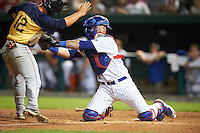 South Bend Cubs catcher Tyler Alamo (22) tags Matt Thaiss (12) out attempting to score during a game against the Burlington Bees on July 22, 2016 at Four Winds Field in South Bend, Indiana.  South Bend defeated Burlington 4-3.  (Mike Janes/Four Seam Images)
