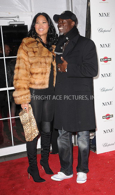 WWW.ACEPIXS.COM . . . . . ....December 15 2009,  New York City....Kimora Lee Simmons and Djimon Hounsou  arriving at the New York premiere of 'Nine' at the Ziegfeld Theatre on December 15 2009 in New York City....Please byline: KRISTIN CALLAHAN - ACEPIXS.COM.. . . . . . ..Ace Pictures, Inc:  ..(212) 243-8787 or (646) 679 0430..e-mail: picturedesk@acepixs.com..web: http://www.acepixs.com
