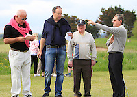 Des Smith (Baltray) points out the 10th to a few friends during the 3rd round of the East of Ireland Amateur Open Championship 2013 Co Louth Golf club 3/6/13<br /> Picture:  Thos Caffrey / www.golffile.ie