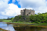 Ancient highland fortress Dunvegan Castle, the Highlands ancestral home of the MacLeod clan, by Dunvegan Loch, a sea loch on the Isle of Skye in Scotland