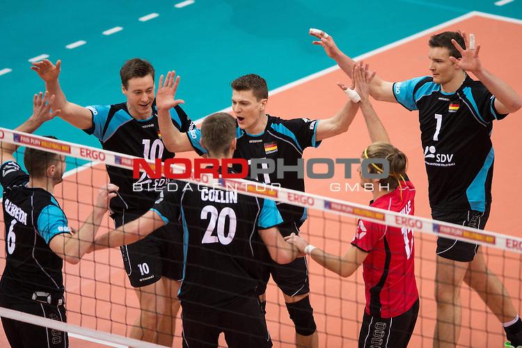04.01.2014, MHP Arena, Ludwigsburg<br /> Volleyball, Qualifikation WM 2014, Deutschland vs. Estland<br /> <br /> Jubel Denis Kaliberda (#6 GER), Jochen Sch&ouml;ps / Schoeps (#10 GER), Philipp Collin (#20 GER), Lukas Kampa (#11 GER), Ferdinand Tille (#12 GER), Christian Fromm (#1 GER)<br /> <br />   Foto &copy; nordphoto / Kurth