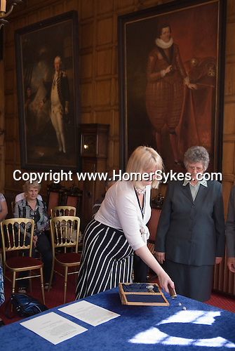 Dicing for Maids Money. Guildhall Guildford. Dawn Page and Frances Farmer who work for Home Support Services ( Guildford)  an organization that supports the frail and vunerable within their own homes. John How charity paid out £60-00 John Parson charity  paid out £62-00.2011.