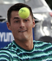 BOGOTA – COLOMBIA – 18-07-2014: Bernard Tomic de Australia, observa la bola durante partido de cuartos de final del Open Claro Colombia de tenis ATP 250, que se realiza en las canchas del Centro de Alto Rendimiento en Altura en ciudad de Bogota.  / Bernard Tomic of Australia, watch the ball, during a match for the quarter of finals of the Open Claro Colombia de tenis ATP 250, at Centro de Alto Rendimiento en Altura in Bogota City. Photo: VizzorImage / Luis Ramirez / Staff.