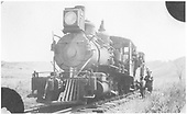 Front 3/4 fireman's-side view of D&amp;RG locomotive #417 and caboose with engine and train crews.<br /> D&amp;RG  near Gunnison, CO  Taken by Price, Earl - ca. 1910