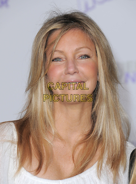 "HEATHER LOCKLEAR .attending the Paramount Pictures' L.A. Premiere of ""Justin Bieber: Never Say Never"" held at The Nokia Theater Live in Los Angeles, California, USA,.February 8th 2011..portrait headshot white top tanned  bronzed bronzer make-up smiling                                         .CAP/RKE/DVS.©DVS/RockinExposures/Capital Pictures."
