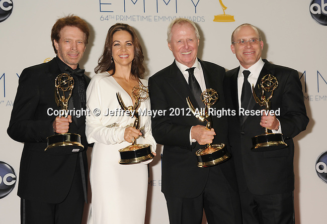 LOS ANGELES, CA - SEPTEMBER 23: Jerry Bruckheimer, Elise Doganieri, Bertram van Munster and Jonathan Littman pose in the press room at the 64th Primetime Emmy Awards held at Nokia Theatre L.A. Live on September 23, 2012 in Los Angeles, California.