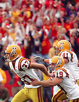 ISU kicker Bret Culbertson (37) celebrates his fifth and game-winning field goal to seal a 15-13 win over Iowa on September 15, 2007 in Ames, Iowa. Holder Josh Griebahn (19) and Ben Barkema (41) cekebrate with him.