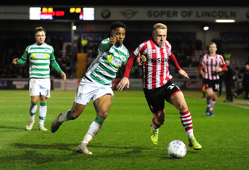 Lincoln City's Danny Rowe battles with Yeovil Town's Rhys Browne<br /> <br /> Photographer Andrew Vaughan/CameraSport<br /> <br /> The EFL Sky Bet League Two - Lincoln City v Yeovil Town - Friday 8th March 2019 - Sincil Bank - Lincoln<br /> <br /> World Copyright © 2019 CameraSport. All rights reserved. 43 Linden Ave. Countesthorpe. Leicester. England. LE8 5PG - Tel: +44 (0) 116 277 4147 - admin@camerasport.com - www.camerasport.com
