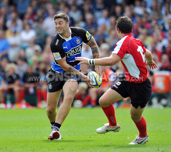 Matt Banahan looks to pass the ball. Pre-season friendly match, between Bath Rugby and London Welsh on August 11, 2012 at the Recreation Ground in Bath, England. Photo by: Patrick Khachfe / Onside Images