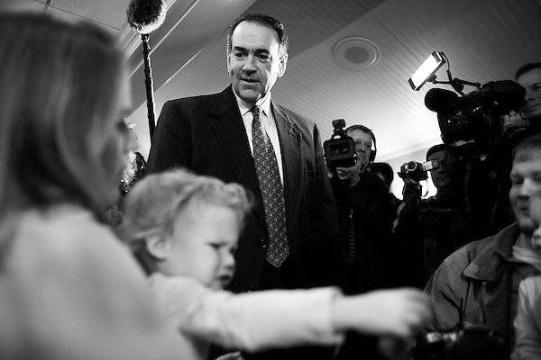 December 8, 2007. Columbia, SC.. Former Arkansas governor and presidential contender Mike Huckabee greeted diners at the Lizard's Thicket Restaurant in Columbia, SC, where he discussed his rise in the polls and the future of his campaign.. Huckabee greeted diners Jenny and James Martin, and their daughters Emma (right) and Kate (left).