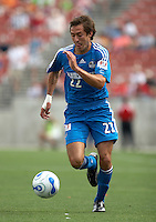 KC Wizards' Davy Arnaud dribbles the ball at Pizza Hut Park on Sunday April 23, 2006. Dallas beat Kansas City 2-1.