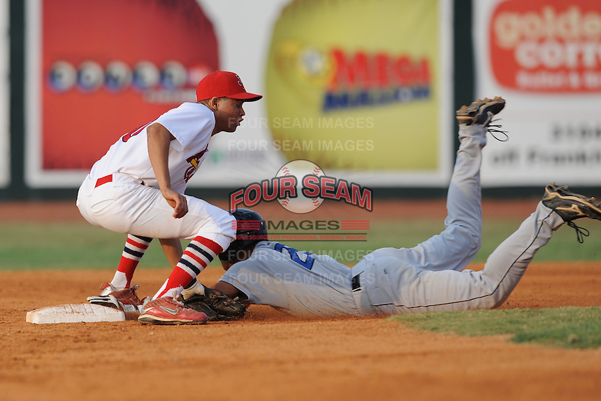 Johnson City Cardinals second baseman Bryvic Valera #10 applies a tag on a hard sliding Dalton Pompey #28 during the first game of the 2011 Championship Series between the Bluefield Blue Jays and the Johnson City Cardinals at Howard Johnson Field on September 3, 2011 in Johnson City, Tennessee.  The Cardinals won the game 4-3.  (Tony Farlow/Four Seam Images)