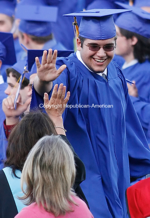 SEYMOUR, CT 06/19/09- 061909BZ11-  Michael Roy high-fives a faculty member after receiving his diploma during commencement excercises at Seymour High School Friday night.<br /> Jamison C. Bazinet Republican-American