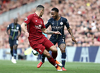 Manchester City's Raheem Sterling under pressure from Liverpool's Dejan Lovren <br /> <br /> Photographer Rich Linley/CameraSport<br /> <br /> The Premier League - Liverpool v Manchester City - Sunday 7th October 2018 - Anfield - Liverpool<br /> <br /> World Copyright &copy; 2018 CameraSport. All rights reserved. 43 Linden Ave. Countesthorpe. Leicester. England. LE8 5PG - Tel: +44 (0) 116 277 4147 - admin@camerasport.com - www.camerasport.com