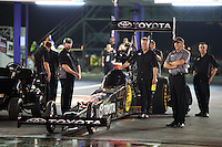 Apr 24, 2015; Baytown, TX, USA; Crew members waiting with NHRA  top fuel driver Shawn Langdon for their turn at the track during qualifying for the Spring Nationals at Royal Purple Raceway. Mandatory Credit: Mark J. Rebilas-