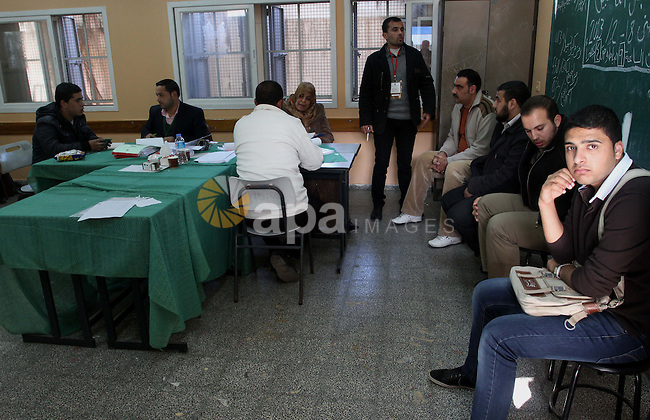 Palestinians update their details at a centre run by the Palestinian Central Election Commission (CEC), in Gaza city on February 12, 2013. The Palestinian Central Election Commission (CEC) began on Monday registering voters in Gaza and the West Bank for an upcoming election that is hoped to help with healing nearly six years of political rifts among rival factions. Photo by Naaman Omar