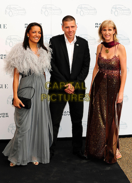 GUESTS.Attends the Range Rover 40th Anniversary Party in association with Vogue at the Orangery, Kensington Palace, London, England, UK..July 1st 2010.full length black brown grey gray maxi dress fur wrap suit clutch bag .CAP/CJ.©Chris Joseph/Capital Pictures.