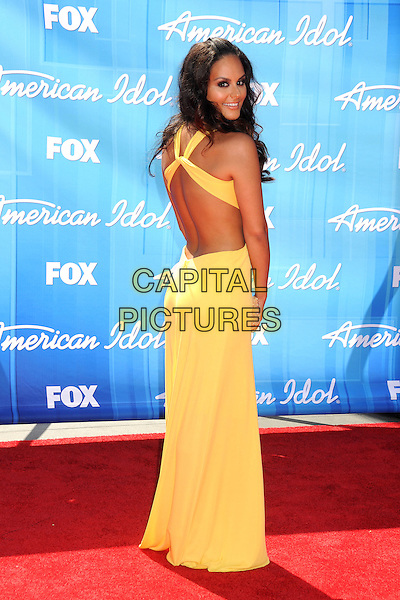 Pia Toscano.American Idol Season 11 Finale - Arrivals held at Nokia Theatre LA Live, Los Angeles, California, USA..May 23rd, 2012.full length yellow dress backless straps looking over shoulder .CAP/ADM/BP.©Byron Purvis/AdMedia/Capital Pictures.