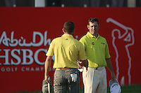 Lee Westwood (ENG) and Sergio Garcia (ESP) finish their match on the 18th green during Thursday's Round 1 of the HSBC Golf Championship at the Abu Dhabi Golf Club, United Arab Emirates, 26th January 2012 (Photo Eoin Clarke/www.golffile.ie)