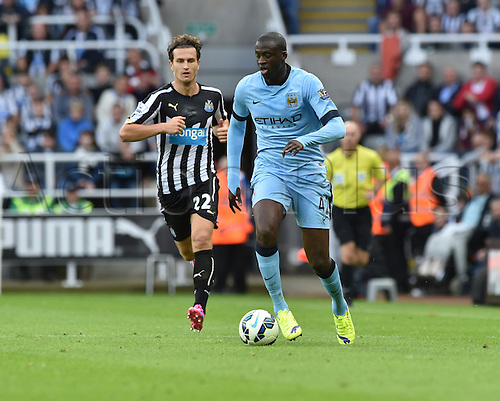 17.08.2014.  Newcastle upon Tyne, England. Premier League. Newcastle United versus Manchester City. Manchester city midfielder Yaya Toure controls the ball
