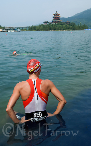 11 SEP 2011 - BEIJING, CHN - Danne Boterenbrood (NED) prepares herself before the start of the 2011 Elite Womens ITU World Championship Series Grand Final Triathlon .(PHOTO (C) NIGEL FARROW)