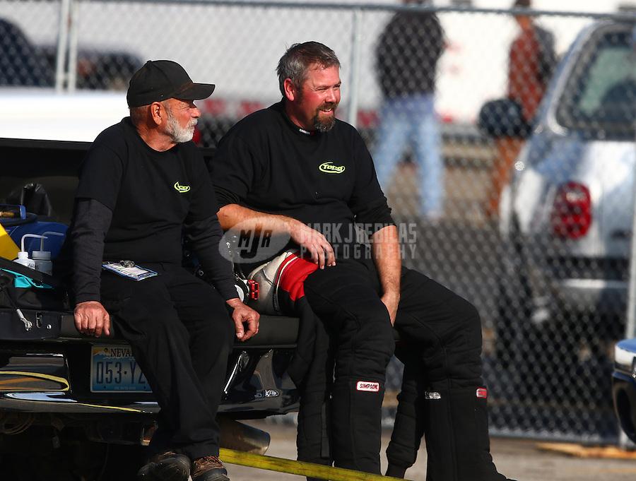 Feb 8, 2014; Pomona, CA, USA; NHRA top alcohol funny car driver Nicholas Januik during qualifying for the Winternationals at Auto Club Raceway at Pomona. Mandatory Credit: Mark J. Rebilas-