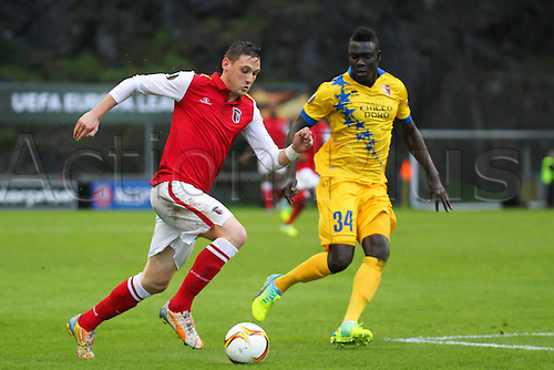 24.02.2016. Braga, Portugal. Stojiljkovic of SC Braga challenges Ndoye of FC Sion, during the UEFA Europa League match, Round of 32 - 2nd Leg, at Estadio Municipal de Braga, in Braga. Braga versus FC Sion