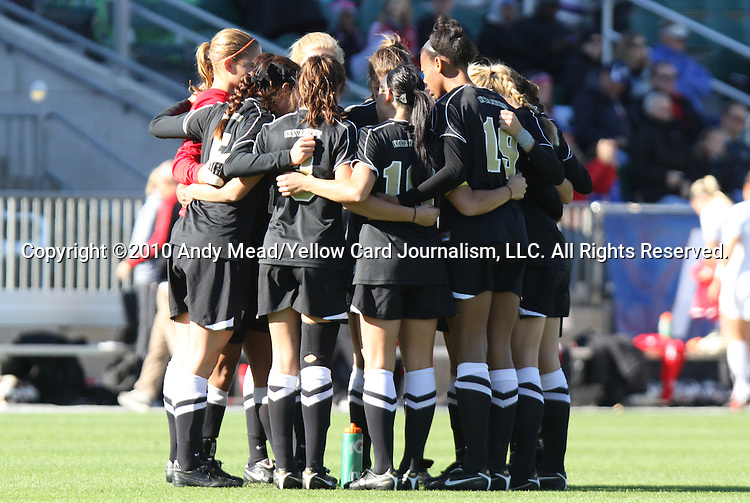 07 November 2010: Wake Forest's starters huddle before the game. The Wake Forest University Demon Deacons defeated the University of Maryland Terrapins 3-1 on penalty kicks after the game ended in a 1-1 tie after overtime at WakeMed Stadium in Cary, North Carolina in the ACC Women's Soccer Tournament championship game.