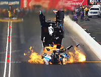 Feb 25, 2018; Chandler, AZ, USA; NHRA funny car driver John Force explodes the body off his car on fire during the Arizona Nationals at Wild Horse Pass Motorsports Park. Mandatory Credit: Mark J. Rebilas-USA TODAY Sports