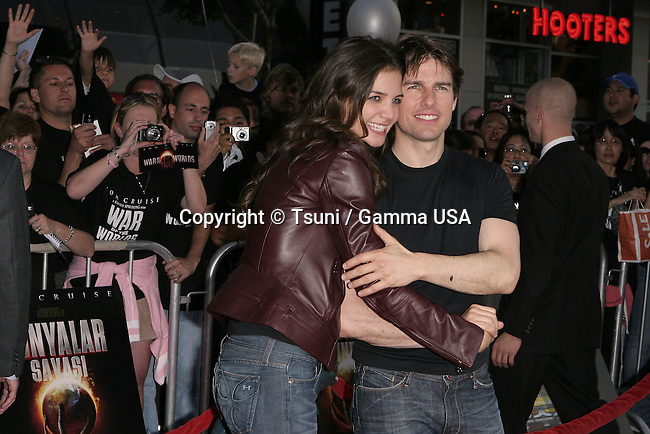 Tom Cruise and Katie Holmes arriving at the Fan Screening of War Of The Worlds at the Chinese  Theatre in Los Angeles. June 27, 2005.