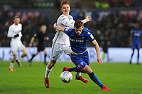 George Byers of Swansea City battles with Callum Connolly of Bolton Wanderers during the Sky Bet Championship match between Swansea City and Bolton Wanderers at the Liberty Stadium in Swansea, Wales, UK.  Saturday 02 March, 2019