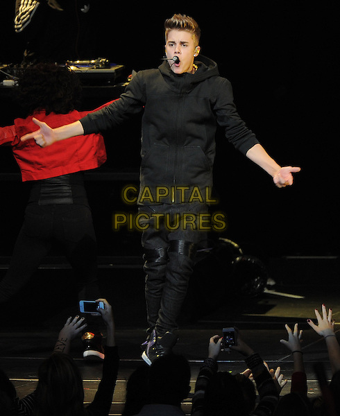 Justin Bieber.KIIS FM Jingle Ball Night 2 held at Nokia Live in Los Angeles, California, USA..3rd December 2012 .on stage in concert music gig performing live performance full length black jeans denim top jacket hands arms singing  .CAP/DVS.©DVS/Capital Pictures.
